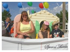 The kids love to sit in the float during the August Elks Lodge Parade. The theme for this year's float was to thank the businesses who helped build our new school.